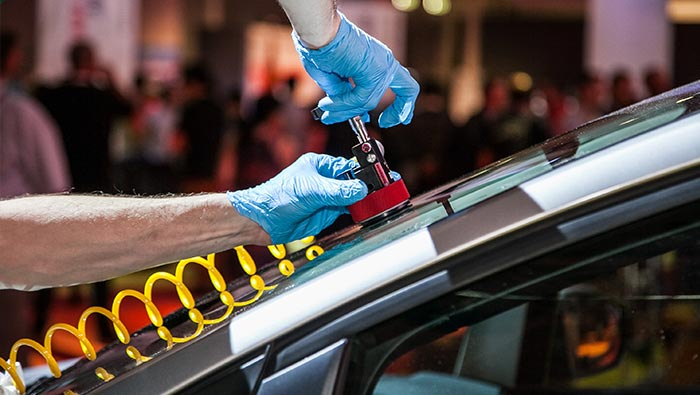 Windscreen chip being repaired with equipment shown on glass